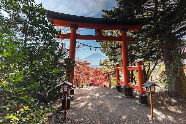 Red torii gate in arakura sengen shrine with mount fuji in autumn season