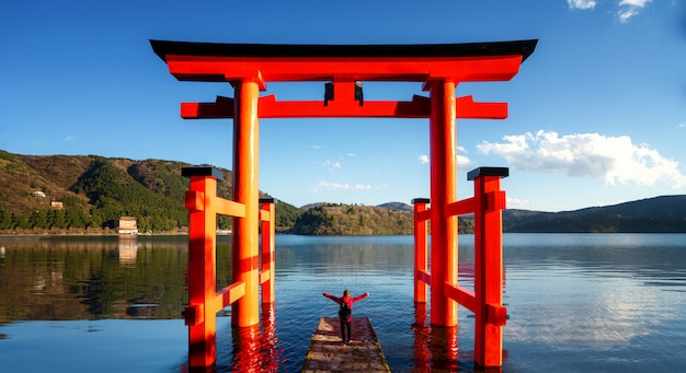 Red torii on the hakone lake, japan