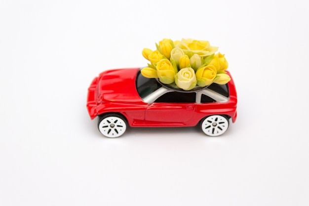 Red toy car, flower delivery, valentine's day, concept