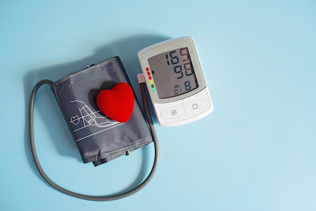 Red toy heart and tonometer