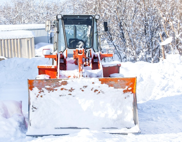 Red tractor for snow removal