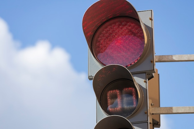 Red traffic light against the blue sky. high quality photo