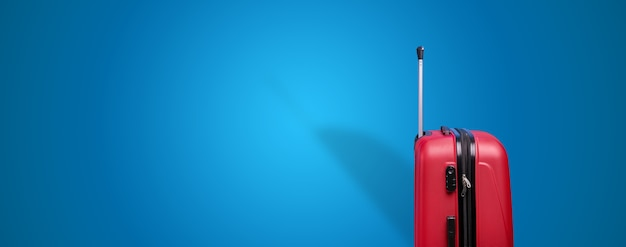 Red travel suitcase over blue