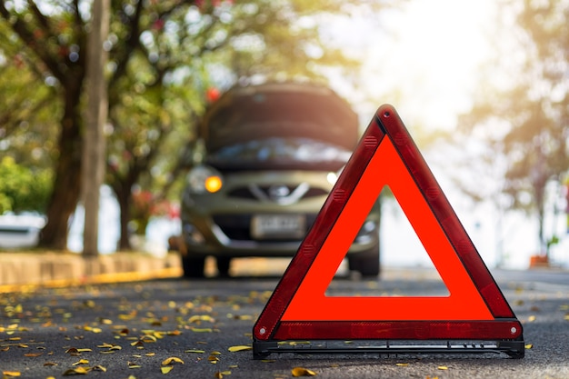 Red triangle, red emergency stop sign, red emergency symbol and  car stop and park on road.