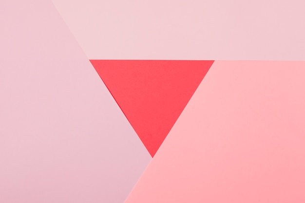 Red triangle surrounded with pink paper background
