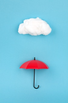 Red umbrella under the cloud on sky blue