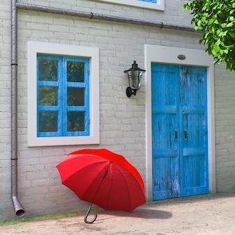 Красный зонтик перед ретро винтажным европейским жилым домом, крайним крупным планом сцены узкой улицы. 3d рендеринг