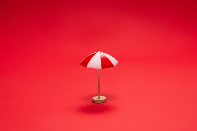 Red umbrella on a red background. copy space.