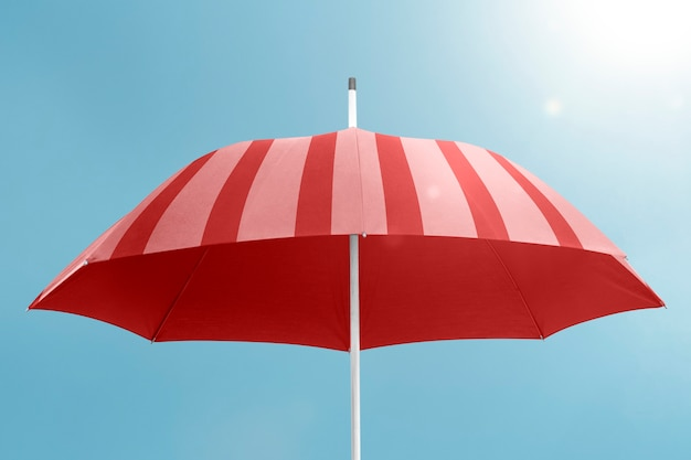 Red umbrella with copy space on blue sky background