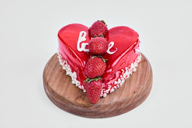 Red valentine cake in heart shape.