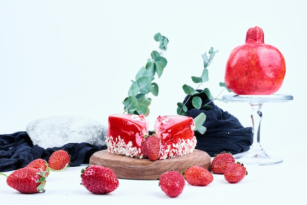 A red valentine cake with fruit.