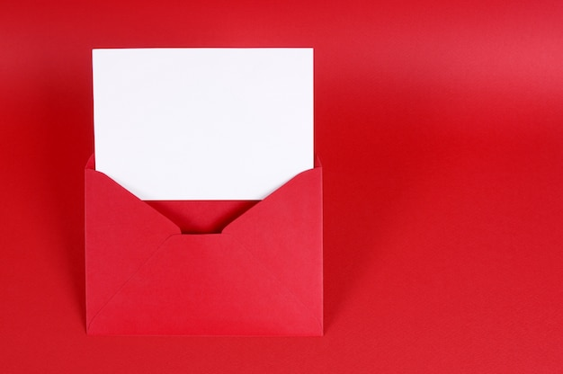 Red valentine envelope with a card
