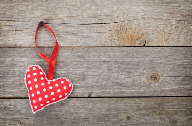 Red valentine's day heart toy. on wooden background with copy space