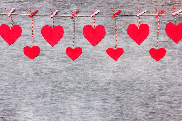 Red valentine's love hearts on rustic driftwood texture background, copy space