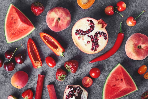 Red vegetable and fruit on the gray