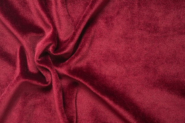Red velvet background. abstract textile texture with waves.