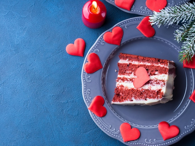 Red velvet cake slice for valentines day dessert. sweet treat for romantic date or christmas party.