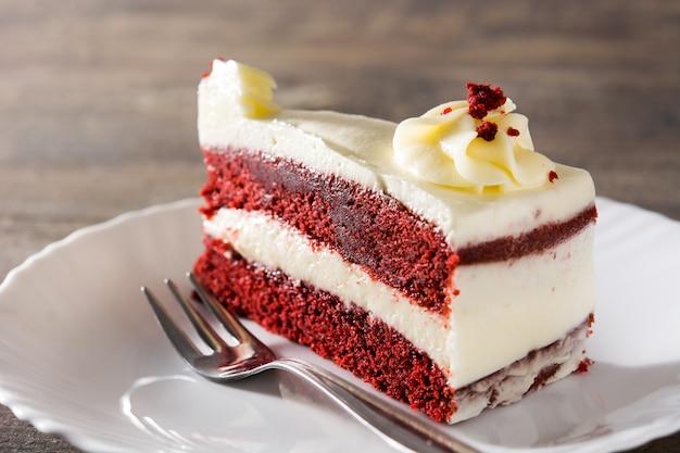 Red velvet cake slice on wooden table