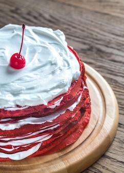 Red velvet crepe cake on the wooden board
