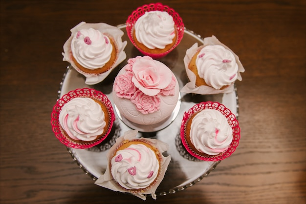 Red velvet cupcakes for valentines day in bright colorful setting, selection focus