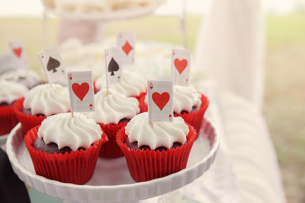 Red velvet cupcakes with playing cards toppers