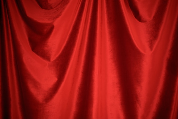 Red velvet fabric background close up