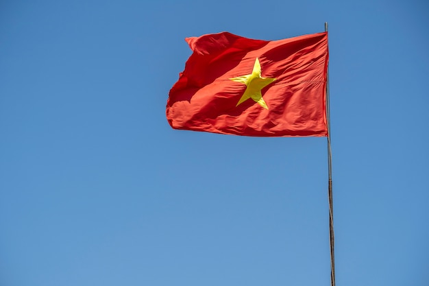 Red vietnam flag against the blue sky