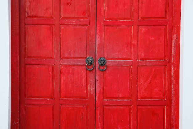 Red vintage retro wooden door on white wall background