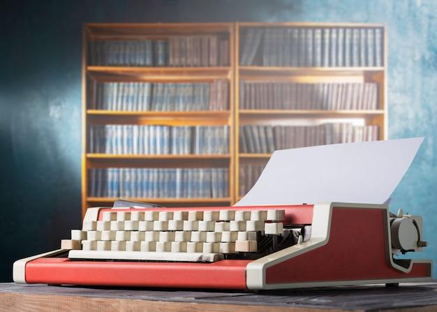 Red vintage typewriter and bookshelf