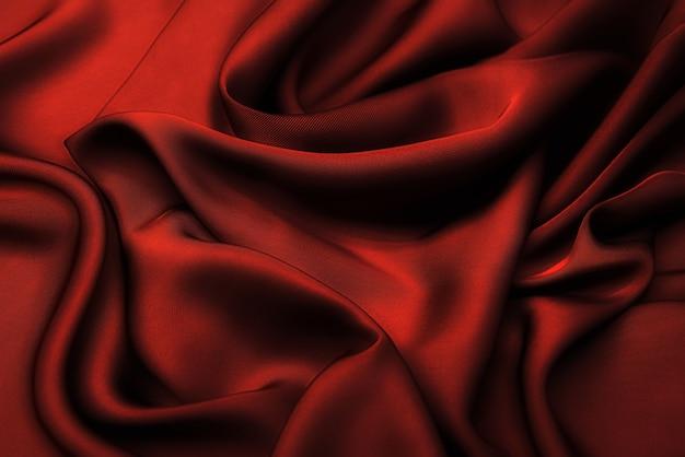 Текстура красной вискозной ткани. фон, узор.