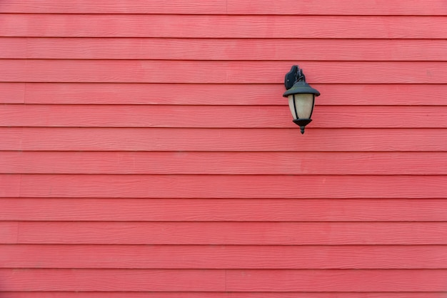 Red wall lamp in a park