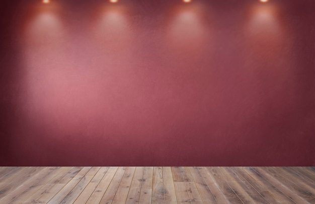 Red wall with a row of spotlights in an empty room
