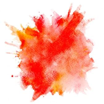 紙の上の赤い水彩ブラシ。