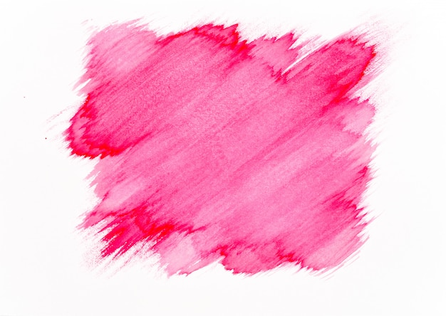 Red watercolor brush stroke on white paper background.