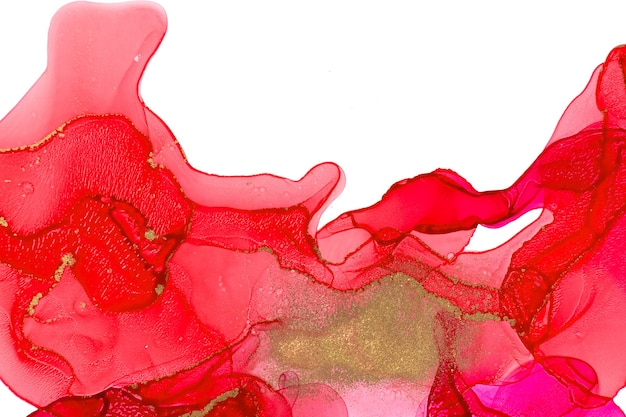 Red watercolor inks isolated on white background.