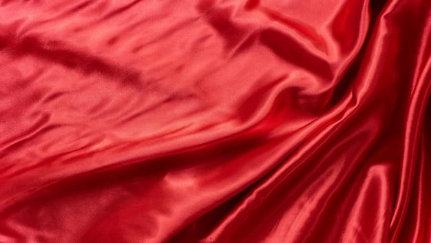 赤い波生地パターンの抽象的な背景