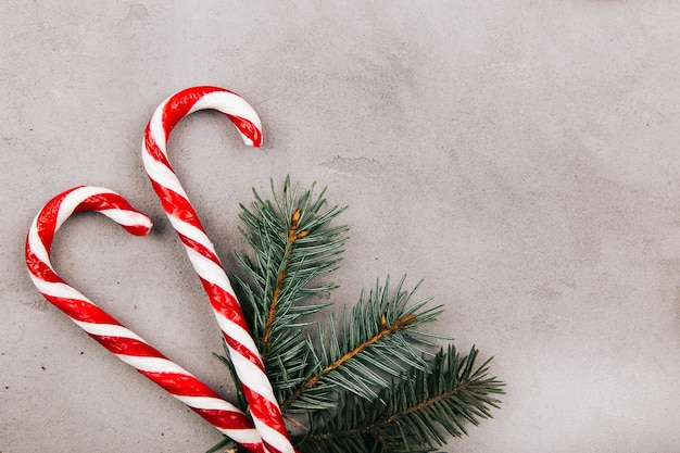 Red white candies and fir branch lie on the floor