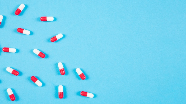 Red and white capsules on blue background