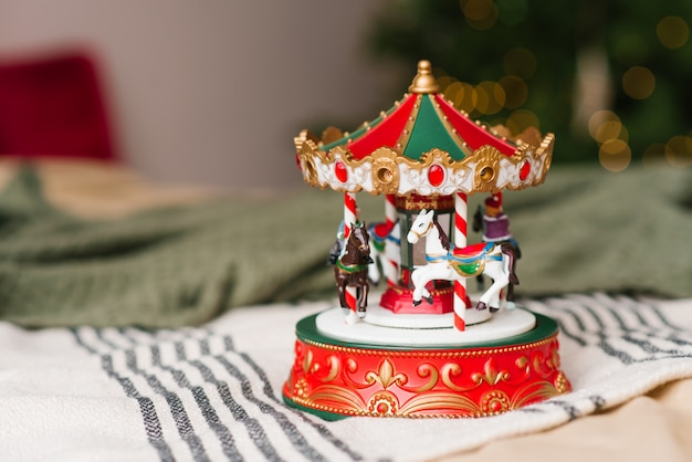 Red and white carousel toy on christmas lights