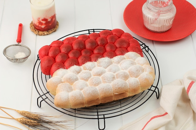 Red and white chigiri bubble bread pull apart bread, fresh viral white japanese bubble bread on black background. concept for indonesia independence day (17 agustus)