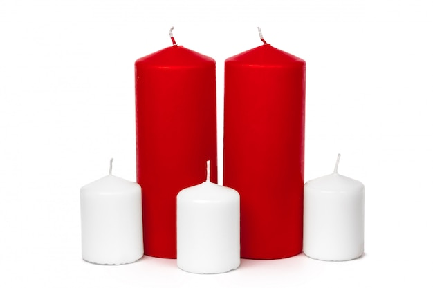 Red and white colored xmas candles isolated on white