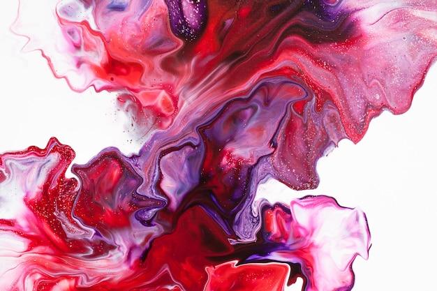 Красный белый жидкий искусство абстрактного фона. текстура красочной жидкой краски