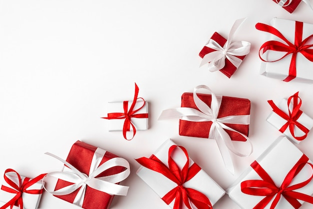 Red and white gift boxes on white background top view happy holidays valentines day birthday merry christmas and happy new year