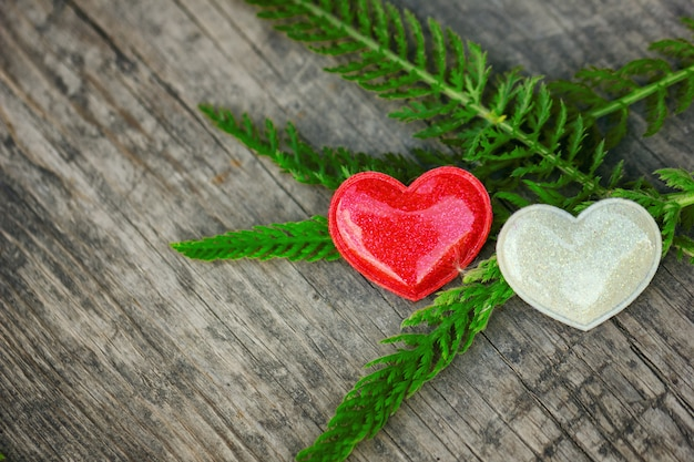 Red and white heart lie on wooden background