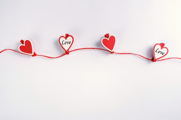 Red and white hearts hanging on rope. valentine's day concept.