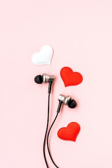 Red and white hearts with black music earphones