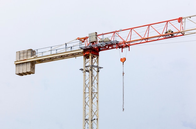 Red and white  hoisting crane