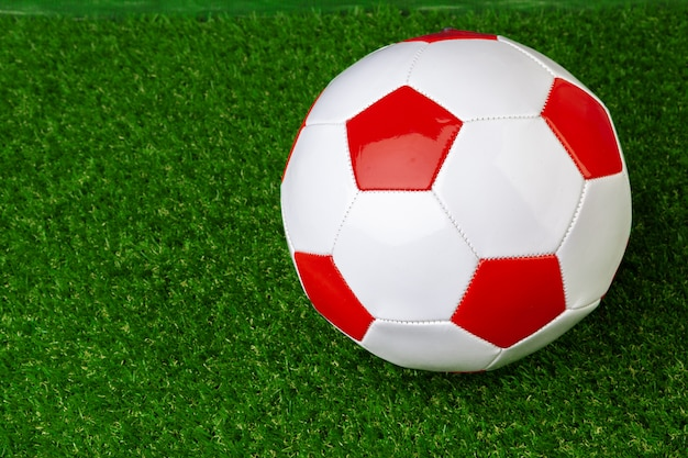 Red and white leather soccer ball