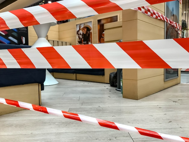 Red and white lines of barrier tape at entrance to e-cigarette smoking booth