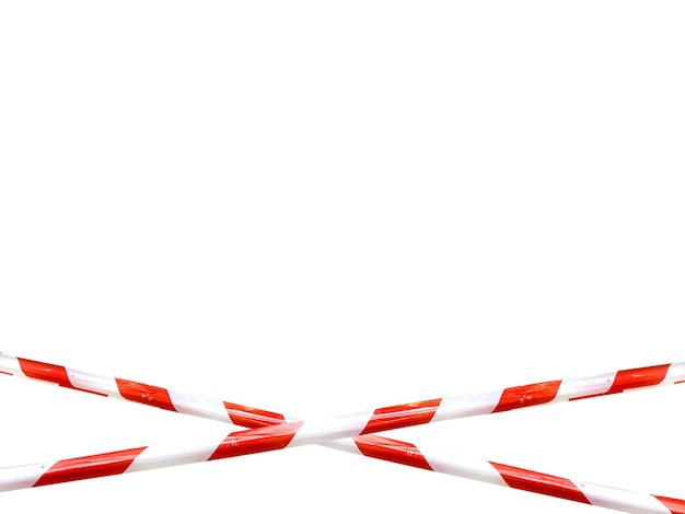 Red and white lines of barrier tape prohibit passage. barrier tape on white isolate. barrier that prohibits traffic. warning tape